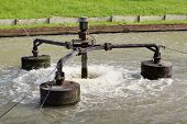stock photo of aeration  - Water treatment by aerator in public park - JPG