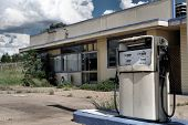 foto of fuel pump  - A silent pump guards an abandoned gas station - JPG