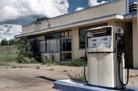 stock photo of fuel pump  - A silent pump guards an abandoned gas station - JPG