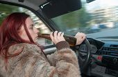 Drunk Woman Driving Car With Beer In Hand