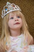 stock photo of toddlers tiaras  - A small blond girl wearing a princess tiara - JPG