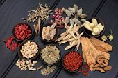 stock photo of licorice  - Chinese herbal medicine selection in wooden bowls and loose - JPG