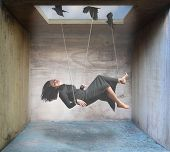 image of gravity  - a woman being carried by birds in a box - JPG