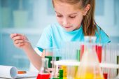 image of chemistry  - little girl with flasks for chemistry - JPG