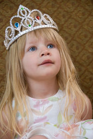 picture of toddlers tiaras  - A small blond girl wearing a princess tiara - JPG