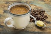 picture of ghee  - a cup of fresh fatty coffee with butter and coconut oil  - JPG