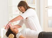 pic of reiki  - Professional Reiki healer doing reiki treatment to young woman - JPG