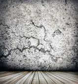 Background of age grungy white texture of paint stucco brick and stone wall with dark wooden floor i