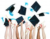 stock photo of tassels  - Diversity of People Holding Certificates and Throwing Graduation Caps - JPG