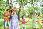 foto of hula hoop  - Children Playing with Hula Hoops in Park - JPG