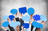 stock photo of hand gesture  - Diverse Hands Holding Blue Speech Bubbles - JPG