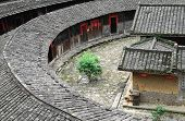 image of semi-circle  - Hakka Roundhouse tulou walled village located in Fujian - JPG