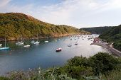 Sailing Boats Moored In The Scenic Harbor Of Solva, Wales