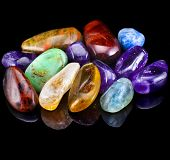 stock photo of agate  - Group of natural colorful raw gemstones on black  background - JPG
