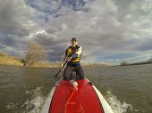 foto of collins  - mature male paddler in wetsuit and life jacket enjoying workout on a stand up paddleboard  - JPG