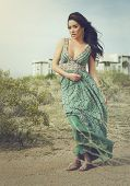 Ethereal woman posing in desert landscape Spring sunlight.  Full length photo - soft haze fashion fe