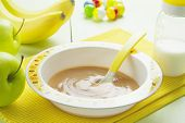 stock photo of teats  - Fruit puree in a bowl on the table baby food - JPG