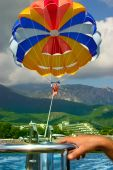 picture of parasailing  - Young pretty woman having fun  - JPG