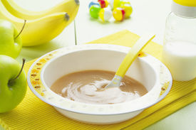 picture of teats  - Fruit puree in a bowl on the table baby food - JPG