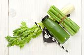 pic of celery  - Vegetable juice in bottle with celery stalk on white wood background - JPG