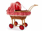 stock photo of baby doll  - An old vintage childrens doll stroller over a white background - JPG