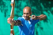 image of archer  - Bowman or archer aiming at target with bow and arrow - JPG