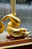 stock photo of barge  - Stylised fish detail of royal barge in gold