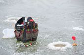 picture of ice fishing  - Backpack with fishing equipment for winter fishing - JPG