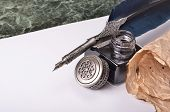 foto of inkwells  - antique vintage blue pen and inkwell on the paper - JPG