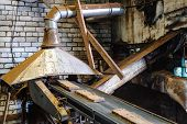 foto of briquette  - forming machine for pressing peat fuel briquettes at the factory - JPG