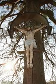 image of crucifiction  - christian wayside cross with jesus statue place of pilgrimage - JPG