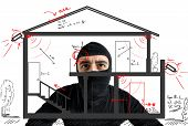 picture of theft  - Thief apartment studying security system of a new house - JPG
