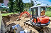 stock photo of excavator  - A family house is being rebuilt with the help of an excavator - JPG