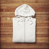 pic of hooded sweatshirt  - White hooded sweater on wood desk background - JPG