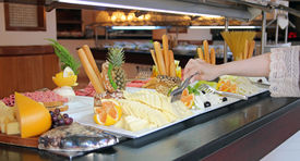 picture of all-inclusive  - Buffet Catering Food Arrangement on Table.  People Serving at Buffet. All inclusive. Breakfast buffet. - JPG