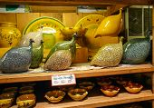 pic of pottery  - Beautiful Guinea Hens with pottery on wooden shelves - JPG