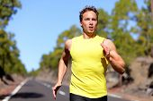stock photo of breathing exercise  - Running man sprinting for success on run - JPG