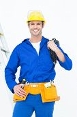 picture of electrician  - Portrait of happy electrician with wires against white background - JPG
