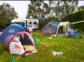 foto of campervan  - Campsite With Pitched Tents And Campervan  - JPG