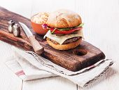 stock photo of burger  - Burger with coleslaw on white wooden background - JPG