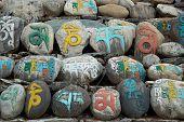 pic of tibetan  - Tibetan colorful prayer stones with letters - JPG