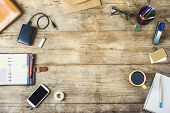 stock photo of tables  - Mix of office supplies and gadgets on a wooden desk background - JPG