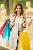 foto of shopping center  - Beauty woman with shopping bags in shopping mall is looking at the camera - JPG