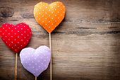 stock photo of valentines  - Valentines Vintage Handmade Hearts over Wooden Background - JPG
