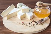 pic of brie cheese  - cheese plate with Brie Camembert Roquefort on wooden plate - JPG