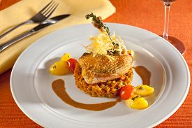 picture of guinea fowl  - Fried chicken guinea fowl on red lentils with vegetables red cherry tomatoes potatoes and port wine sauce decorated with very thin grilled crispy potatoe stripes - JPG