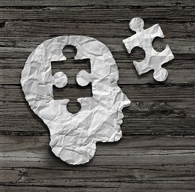 image of headings  - Puzzle head brain concept as a human face profile made from crumpled white paper with a jigsaw piece cut out on a rustic old wood background as a mental health symbol - JPG
