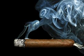pic of tobacco smoke  - cigar with smoke on black background closeup - JPG