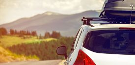 foto of recreational vehicle  - car for traveling with a roof rack on a mountain road - JPG