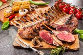 picture of grill  - Grilled Rack of lamb on a cutting board - JPG